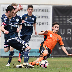 BRISBANE, AUSTRALIA - NOVEMBER 12: Benjamin Carrigan of the Victory is tackled by Joe Caletti of the Roar during the round 1 Foxtel National Youth League match between the Brisbane Roar and Melbourne Victory at Spencer Park on November 12, 2016 in Brisbane, Australia. (Photo by Patrick Kearney/Brisbane Roar)