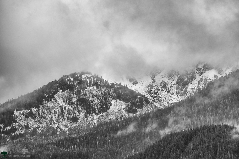 While walking around Downtown Juneau, I looked across the Gastineau Channel and noticed the low clouds on Douglas Island with the fresh snow from some rain which had fallen earlier in the day on the peaks. It was a balance of finding the right break in the clouds as well as an interesting scene to photograph and when a small clearing occurred captured this image.