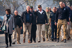 November 17, 2018 - Paradise, California, U.S. - President Donald Trump talks with Congressman Kevin McCarthy as they tour the Skyway Villa Mobile Home and RV Park with Gov. Jerry Brown during his visit of the Camp Fire in Paradise, Calif. on Saturday, November 17, 2018. The Camp Fire in Northern California has become the nation's deadliest wildfire in a century and has killed at least 63 people and left more than 1000 still missing. (Credit Image: © Paul Kitagaki Jr./ZUMA Wire)