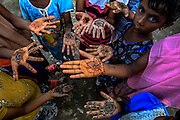 BAYEUN, ACEH, INDONESIA - JULY 11 : <br /> Children of rohingya migrant painting the hands at temporary shelter camp in Bayeun, East Aceh, Indonesia on July 11. 2015. The boatpeople in Aceh are among thousands of Rohingya and Bangladeshi migrants who arrived in countries across Southeast Asia in May after a Thai crackdown threw the people-smuggling trade into chaos.<br /> ©Nira Cahaya/Exclusivepix Media