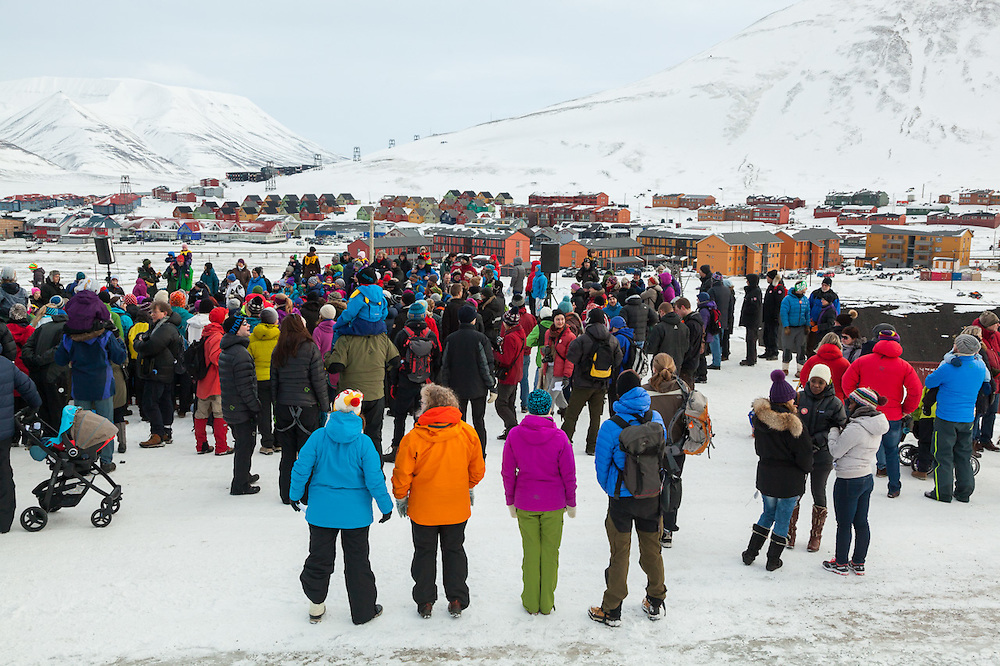 Crowds gather for SolFest in Longyearbyen, Svalbard. The festival marks the official arrival of the sun to the town – by tradition, to the old hospital steps (sykehustrappa).