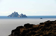 The haunting and beautiful Skellig Rocks off the coast of County Kerry where filming of the latest 'Star Wars' is supposed to take place during Spetember. The rocks are a UNESCO world heritage centre situated 11 miles from Valentia Island and the South Kerry coast. Filming of 'Star Wars 7' is due to take place on Skellig Micheal once inhabited only by monks. A Christian monastery was founded on the island  between the 6th and 8th century, and was continuously occupied until its abandonment in the late 12th century. The remains of this monastery, along with most of the island itself, were inscribed on the UNESCO World Heritage Site list in 1996.<br /> Photo shows the three Skelligs Rocks viewed from the mainland.<br /> Picture by Don MacMonagle
