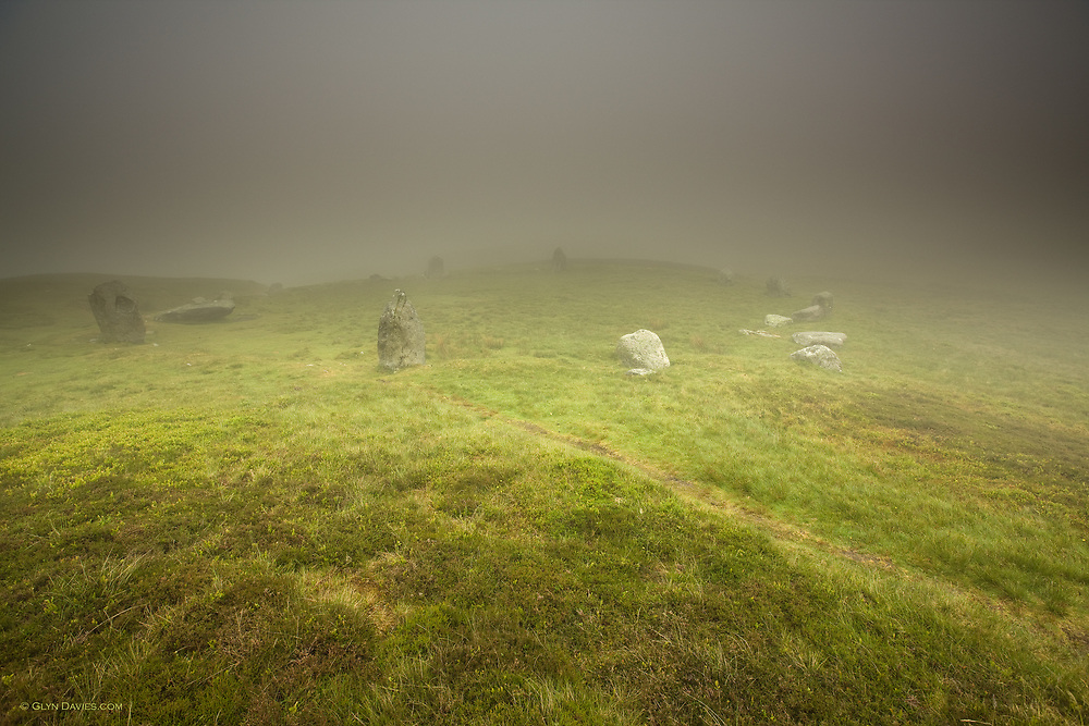 """The stone circle of standing stones is called """"Druid's Circle' and sits high o the hill tops above the town of Penmaenmawr."""