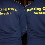 "Jazz Munteanu, left, and Karin Stjarnefyr (umlaut on the ""a""), both of Sweden, pose for a photo wearing their warm-up jackets before competing in the adult women's latin division of the same-sex ballroom dancing competition during the 2007 Eurogames at the Waagnatie hangar in Antwerp, Belgium on July 13, 2007. ..Over 3,000 LGBT athletes competed in 11 sports, including same-sex dance, during the 11th annual European gay sporting event. Same-sex ballroom is a growing sports that has been happening in Europe for over two decades."