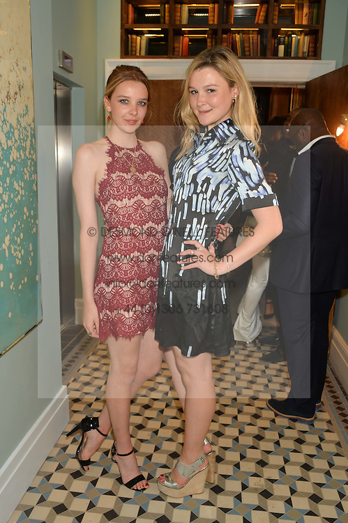 Left to right, GRETA BELLAMACINA and AMBER ATHERTON at the Grand opening of Library - a new members club at 112 St Martin's Lane, London on 25th June 2014.
