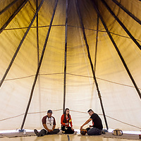 Randell Morris, left, Nicole Brown and Giovanni Dinet sing inside a teepee during the Planting Our Future event at Twin Lakes Elementary Wednesday.