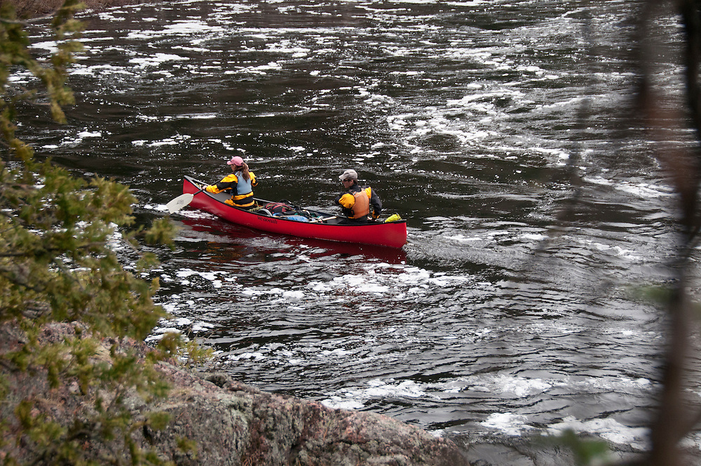 Canoeists on the Agawa River of Ontario Canada.