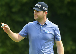 August 12, 2018 - St. Louis, Missouri, U.S. - ST. LOUIS, MO - AUGUST 12: Ryan Fox acknowledges the applause from the crowd after sinking a birdie putt on the #1 green during the final round of the PGA Championship on August 12, 2018, at Bellerive Country Club, St. Louis, MO.  (Photo by Keith Gillett/Icon Sportswire) (Credit Image: © Keith Gillett/Icon SMI via ZUMA Press)