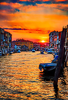 """""""Pastel Sunset of the Venetian Canal""""…<br /> <br /> I never knew quite where I was going in Venice, but just followed the canal, or became trapped by the canals with no way of crossing and had to backtrack. Probably not the best way to traverse the Venice Lagoon. My last evening in Venice I accidentally stumbled on Ponte dei Scalzi, """"bridge of the barefoot [monks],"""" one of only four bridges in Venice to span the Grand Canal. The bridge connects the Sestieri of Santa Croce and Cannaregio. I set up my camera facing east in view of the dome and campanile of Chiesa di San Geremia, which contains the relics of Saint Lucy, the patron saint of our eyes. After taking many images of the descending sun, I decided to follow the sun by way of the church of San Geremia taking a hard left northwest along the Cannaregioa Canal, and taking this photo of the setting sun from the bridge, Ponte delle Guglie. After the sunset, I found my way back to my favorite restaurant, Hosteria Al Vecio Bragosso. Che Dio Benedica l'Italia!"""