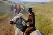 Horse riding in Southern Iceland. <br /> Hvitardalur. Franziska, a dedicated rider from Germany working with the horses for the summer.
