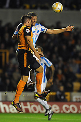 Wolverhampton Wanderers' Danny Batth and Huddersfield Town captain, Mark Hudson challenge for the ball - Photo mandatory by-line: Dougie Allward/JMP - Mobile: 07966 386802 - 01/10/2014 - SPORT - Football - Wolverhampton - Molineux Stadium - Wolverhampton Wonderers v Huddersfield Town - Sky Bet Championship