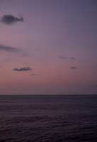 Pastel colored sky and clouds over the Pacific Ocean at dawn.  Image 19 of 21  for a panorama taken with a Fuji X-T1 camera and 35 mm f/1.4 lens  (ISO 400, 35 mm, f/2.8, 1/30 sec). Raw images processed with Capture One Pro and stitched together with AutoPano Giga Pro.