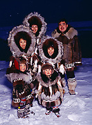 The Rexford fammily wearing traditional Eskimo parkays made by Nora Rexford (top center), Arctic Ocean Coast, Barrow, Alaska.