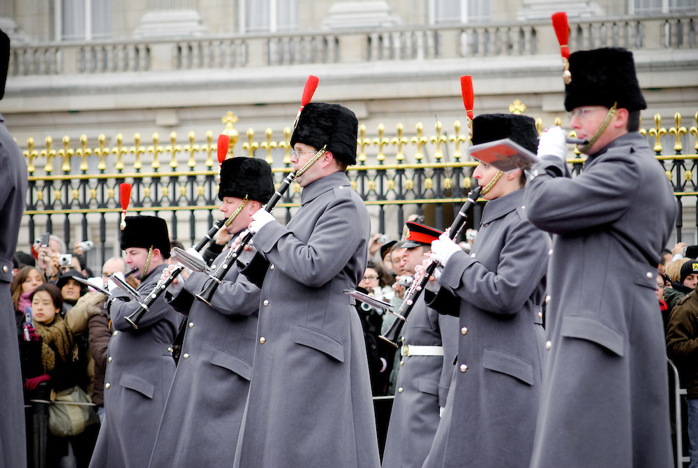 Marching band forms part of the ceremony at the changing of the guard at Buckingham Palace, London.