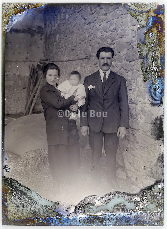 couple with little baby posing on severely eroding glass plate