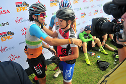 PAARL SOUTH AFRICA - MARCH 23: Raiza Henrique and Amy Beth congratulate each other after the 70km final day, stage 7 on March 23, 2018 Wellingtion to Paarl, South Africa. Mountain bikers gather from around the world to compete in the 2018 ABSA Cape Epic, racing 8 days and 658km across the Western Cape with an accumulated 13 530m of climbing ascent, often referred to as the 'untamed race' the Cape Epic is said to be the toughest mountain bike event in the world. (Photo by Dino Lloyd)