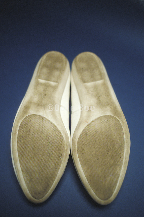 soles of a pair of woman shoes