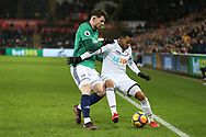 Martin Olsson of Swansea city holds off Oliver Burke of West Bromwich Albion. Premier league match, Swansea city v West Bromwich Albion at the Liberty Stadium in Swansea, South Wales on Saturday 9th December 2017.<br /> pic by  Andrew Orchard, Andrew Orchard sports photography.