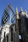 The Swiss Re Building (also known as the Gherkin) is surrounded by historical buildings in the City of London