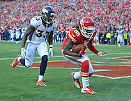 KANSAS CITY, MO - DECEMBER 01:  Wide receiver Junior Hemingway #88 of the Kansas City Chiefs catches a touchdown pass against linebacker Steven Johnson #53 of the Denver Broncos during the first half on December 1, 2013 at Arrowhead Stadium in Kansas City, Missouri.  (Photo by Peter Aiken/Getty Images) *** Local Caption *** Junior Hemingway;Steven Johnson