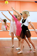 Three young girls enjoy a dance class at The Little Gym in Brentwood on Saturday, May 19, 2012.  (Photo by Kevin Bartram)
