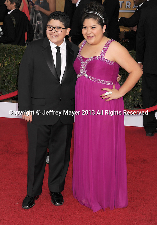 LOS ANGELES, CA - JANUARY 27: Rico Rodriguez and Raini Rodriguez arrives at the 19th Annual Screen Actors Guild Awards at the Shrine Auditorium on January 27, 2013 in Los Angeles, California.