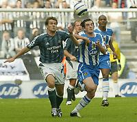 Photo: Aidan Ellis.<br /> Wigan Athletic v Newcastle United. The Barclays Premiership. 15/10/2005.<br /> Newcastle's Michael Owen battles with Wigan's Leighton Baines