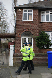 © Licensed to London News Pictures . 13/02/2014 . Manchester , UK . Police outside the home of Anil Khalil Raoufi (aka Abu Layth ) at 78 Brooklawn Drive in Didsbury , Manchester today (13th February 2014) . Raoufi , a British Muslim , is reported to have been killed in fighting in Syria . Photo credit : Joel Goodman/LNP