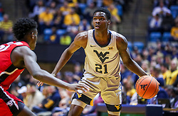 Dec 1, 2018; Morgantown, WV, USA; West Virginia Mountaineers forward Wesley Harris (21) dribbles the ball during the second half against the Youngstown State Penguins at WVU Coliseum. Mandatory Credit: Ben Queen-USA TODAY Sports