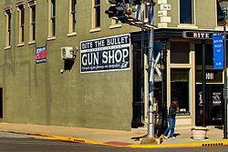 Seymour Indiana - A store named Bite the Bullet Gun Shop is decorated for fall and Halloween<br /> <br /> HDR (High Dynamic Range) post processing applied.