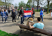 Nederland, Nijmegen, 5-4-2014Demonstratie ter ondersteuning van Geert Wilders en ter veroordeling van de aangifte van burgemeester Bruls, de Nijmeegse wethouders namens de Nijmeegse gemeenteraad. De stoet loopt onder zware politiebegeleiding door de stad naar het politiebureau. Op het spandoek, de nederlandse vlag, staat: geen racist maar realist. Organisator Angelo van den Bos heeft een print met foto's van hem en gekleurde mensen om te bewijzen dat hij ook vrienden heeft onder deze bevolkingsgroep.Foto: Flip Franssen/Hollandse Hoogte