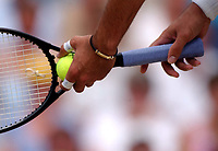 Mark Philippoussis (Australia) serves in the Mens Singles Final with messages on the plasters on his finger and Thumb. Wimbledon Tennis Championship, Day 13, 6/07/2003. Credit: Colorsport / Matthew Impey DIGITAL FILE ONLY