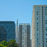 The Trans-America Building is framed by office and apartment buildings in downtown San Francisco, California, as seen from the Embarcadero.
