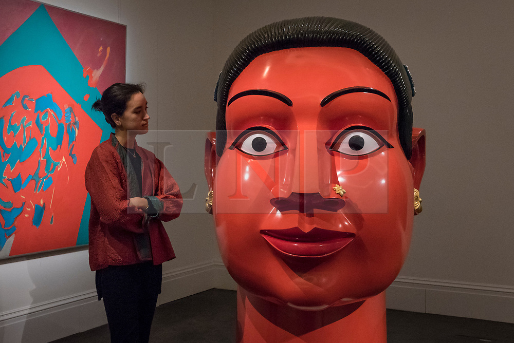 """© Licensed to London News Pictures. 20/10/2017. London, UK. A staff member views """"Untltled (Red Head)"""", 2007, by G. Ravinder Reddy (Est. GBP50-70k), at a preview of Islamic, Middle Eastern and other artworks which be auctioned at Sotheby's New Bond Street on 24 and 25 October. Photo credit : Stephen Chung/LNP"""
