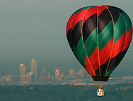 A balloon with Omaha, Nebraska in the background.