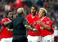 Photo. Chris Ratcliffe<br />Charlton v Birmingham. FA Premiership. 19/04/2003<br />Charlton players, from left, Jason Euell, Tahar El-Khalej and John Robinson surround referee Barry after awarding Birmingham a penalty.