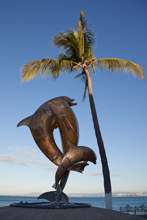 """""""The Dolphins"""" - This statue of Dolphins was photographed at the Malecon in Puerto Vallarta, Mexico."""