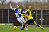 Bristol Rovers Midfielder, Chris Lines (14) and Oxford United Midfielder, Ryan Ledson (8) challenge for the ball during the EFL Sky Bet League 1 match between Oxford United and Bristol Rovers at the Kassam Stadium, Oxford, England on 10 February 2018. Picture by Adam Rivers.