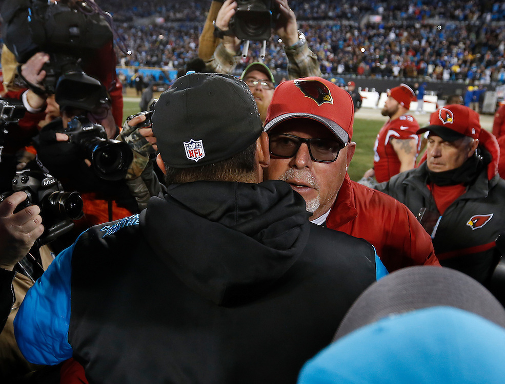 CHARLOTTE, NC - JAN 24:  Head coach Ron Rivera of the Carolina Panthers embraces head coach Bruce Arians of the Arizona Cardinals (center right) after the NFC Championship game at Bank of America Stadium on January 24, 2016 in Charlotte, North Carolina.