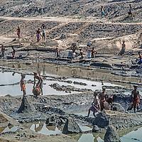 Laborers dig a flood control canal near Dhaka, Bangladesh.