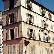 A traditional Parisian apartment block showing symmetrical Architecture.  Paris, France, 28th February 2011 .
