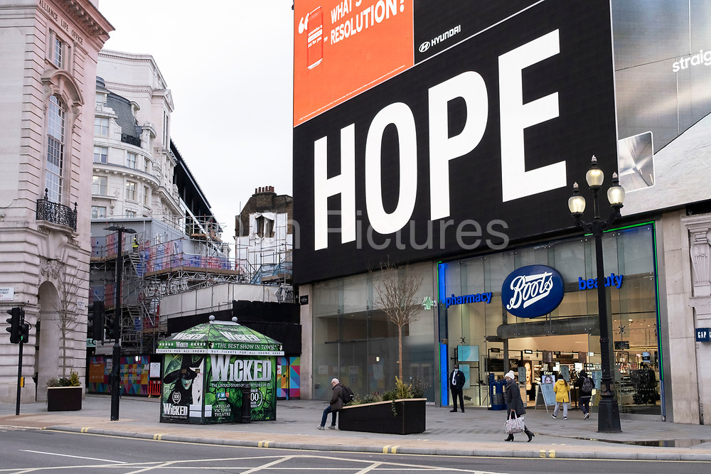At Piccadilly Circus the giant advertising screens show slogans of hope and the faces of coronavirus patients which are part of the latest NHS, Public Health England campaign to encourage people in Britain to take the virus seriously as the national coronavirus lockdown three continues on 29th January 2021 in London, United Kingdom. Following the surge in cases over the Winter including a new UK variant of Covid-19, this nationwide lockdown advises all citizens to follow the message to stay at home, protect the NHS and save lives.