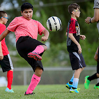 Grants Pirate Julian Louis does drills with the rest of the soccer squad Wednesday at Grants High School.
