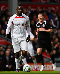 Mario Balotelli attacks for the Carragher XI - Photo mandatory by-line: Matt McNulty/JMP - Mobile: 07966 386802 - 29/03/2015 - SPORT - Football - Liverpool - Anfield Stadium - Gerrard's Squad v Carragher's Squad - Liverpool FC All stars Game