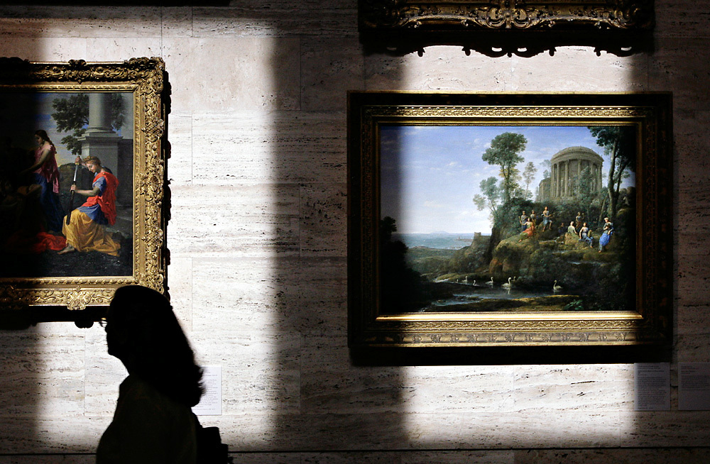 A woman walks through one of the galleries at the Museum of Fine Arts in Boston, Mass.