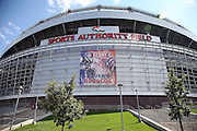 The exterior facade of Sports Authority Field at Mile High stadium is decorated with a banner showing both teams participating in the 2013 NFL kickoff game in the Denver Broncos NFL week 1 season opening football game against the Baltimore Ravens on Thursday, Sept. 5, 2013 in Denver. ©Paul Anthony Spinelli