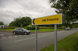 Road sign to the entrance of HMP Featherstone