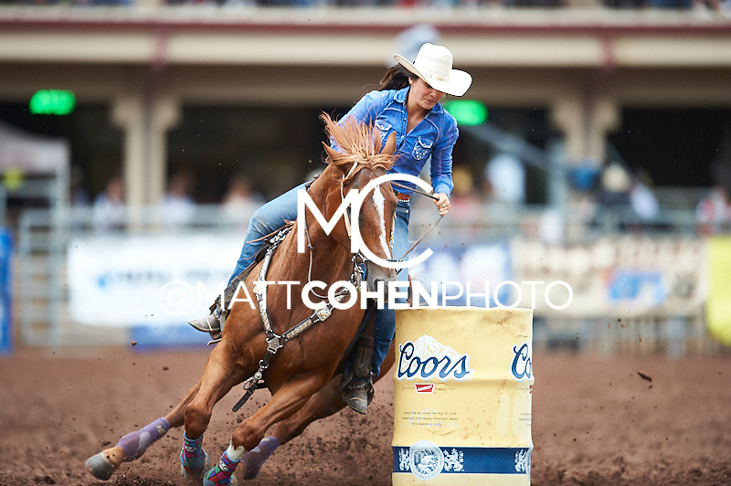Barrel racer Kara Large of Bromide, OK competes at the Pikes Peak or Bust Rodeo in Colorado Springs, CO.<br /> <br /> <br /> UNEDITED LOW-RES PREVIEW<br /> <br /> <br /> File shown may be an unedited low resolution version used as a proof only. All prints are 100% guaranteed for quality. Sizes 8x10+ come with a version for personal social media. I am currently not selling downloads for commercial/brand use.