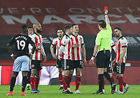 Sheffield United's Phil Jagielka is shown the red card by referee Robert Jones <br /> <br /> Photographer Alex Dodd/CameraSport<br /> <br /> The Premier League - Sheffield United v Aston Villa - Wednesday 3rd March 2021 - Bramall Lane - Sheffield<br /> <br /> World Copyright © 2021 CameraSport. All rights reserved. 43 Linden Ave. Countesthorpe. Leicester. England. LE8 5PG - Tel: +44 (0) 116 277 4147 - admin@camerasport.com - www.camerasport.com