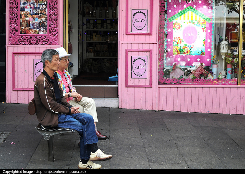 AUSTRALIA - SYDNEY  A man and woman sit on a bench in a street in Sydney's China Town   04/01/2010. STEPHEN SIMPSON...